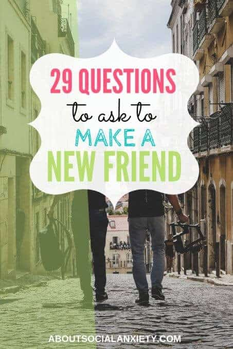 Men walking down the street with text overlay - 29 Questions to ask to Make a New Friend