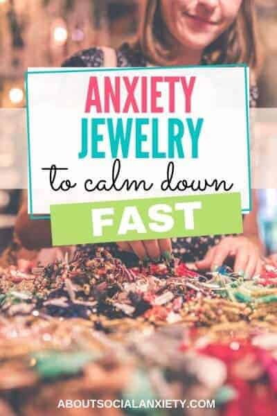 Table of jewelry with text overlay - Anxiety Jewelry to Calm Down Fast