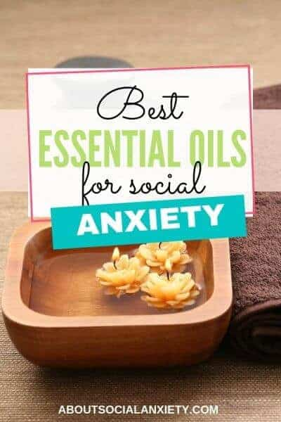 Candles in bowl with text overlay - Best Essential Oils for Social Anxiety
