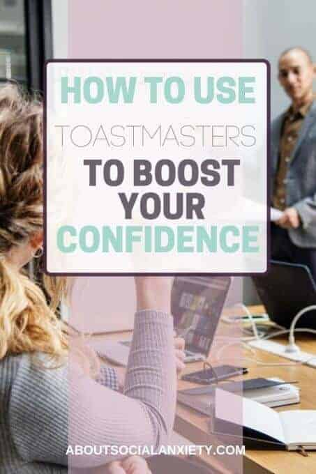 People in a meeting with text overlay - How to Use Toastmasters to Boost Your Confidence