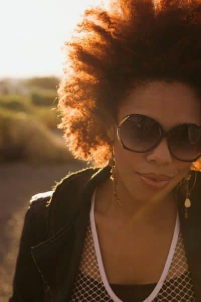Woman wearing sunglasses.